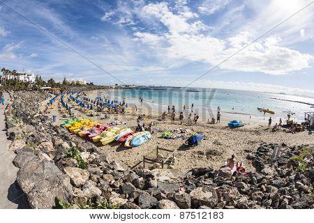 People Enjoy Lying At The Beach Playa Dorada