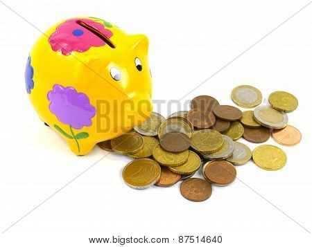 Saved euro's in a yellow money box