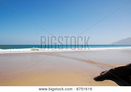 Clean clear beach on a sunny summer day
