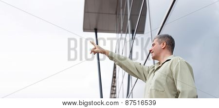Young Businessman Pointing To Sky