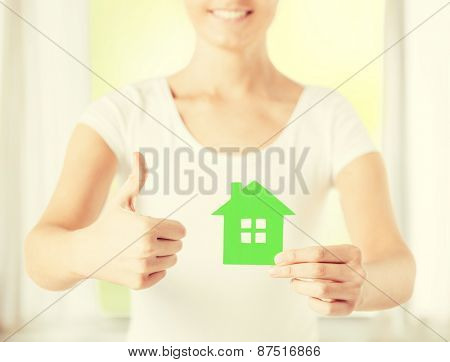 woman hands holding green house showing thumbs up