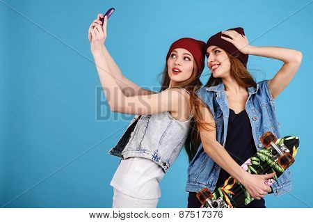 Two Young Women Taking Selfie With Mobile Phone