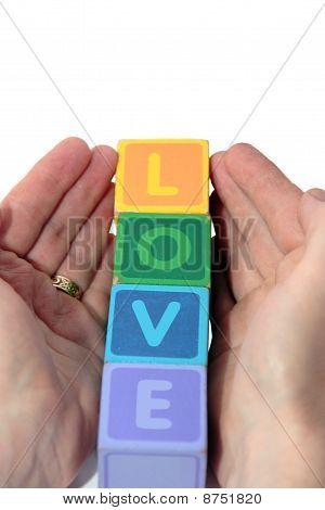 Love In Wood Play Block Letters Held In Hands
