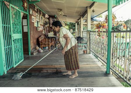 Senior Asian Woman Cleaning House