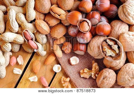 Tasty Nuts On A Wooden Table In Field Top View