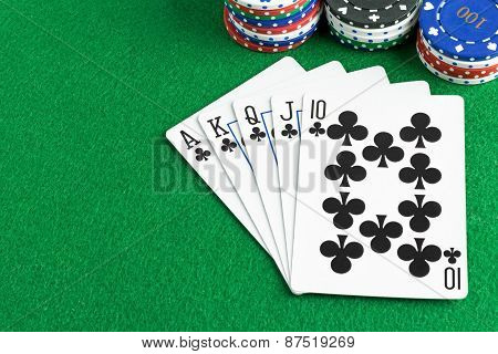 A royal flush poker hand with chips