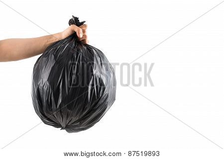 Hand with trash bag