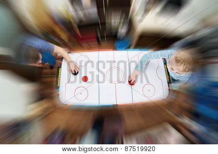Children Playing On Air Hockey