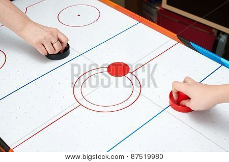 Playing On Air Hockey