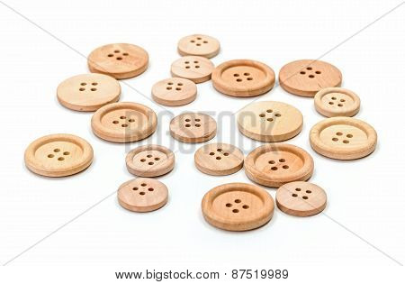 Wooden Buttons On White Surface