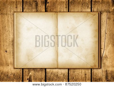 Note Book On A Wood Background
