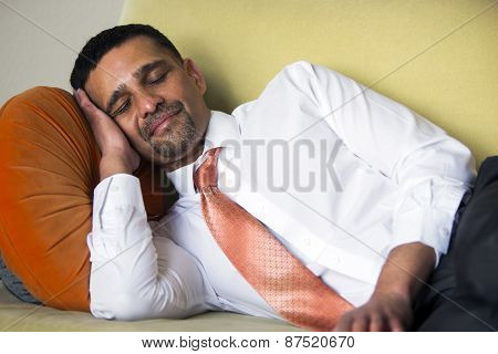 Businessman Lying On Couch