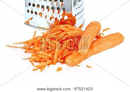 Carrots grated and whole with grater