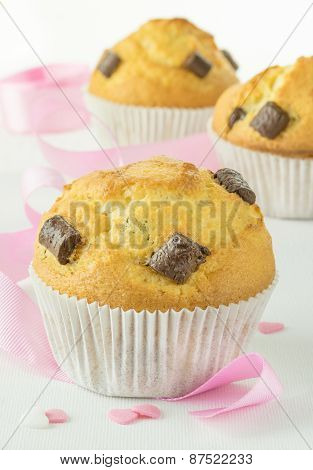 Chocolate chip muffins with pink ribbon