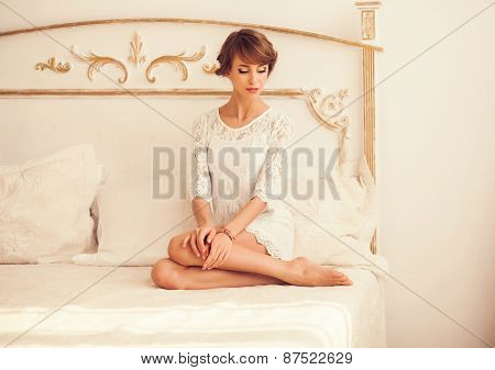 Young Woman In A Bright Bedroom