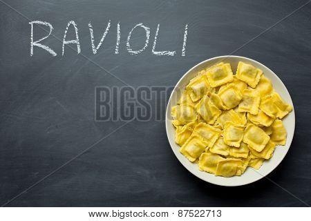 cooked ravioli pasta on chalkboard