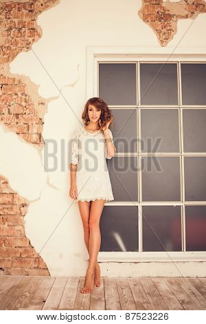 Pretty Girl Standing Barefoot On The Wooden Floor