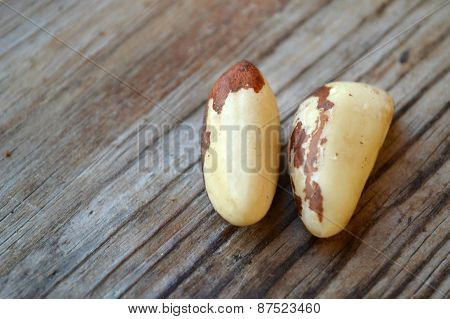 Bunch of Brazil nuts on wooden table