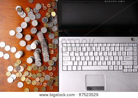 Laptop computer and coins