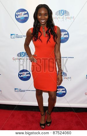 NEW YORK-MAR 28: Model Damaris Lewis attends the 2015 Garden Of Laughs Comedy Benefit at the Club Bar and Grill at Madison Square Garden on March 28, 2015 in New York City.