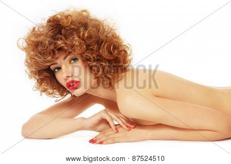 Young slim beautiful sexy woman with curly hair and fancy make-up over white background