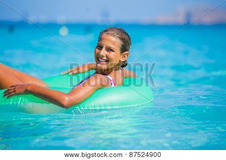 Girl relaxing in the sea