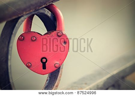 Vintage Padlock Of Red Color On Fence