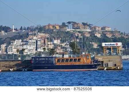 ISTANBUL, TURKEY - MARCH 22, 2014: People on the Galatasaray islet. Since 1957, the islet is owned by Galatasaray sport club, which in 2002 starts to turn it into one of landmarks of the city
