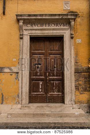 Historic Roman doorway set in an ochre coloured wall