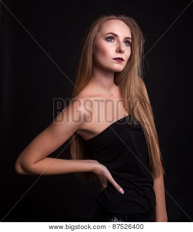Beautiful Woman In Fashion Clothes Over Black Background
