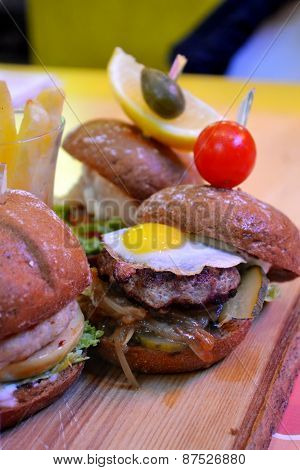 Three cute mini burgers