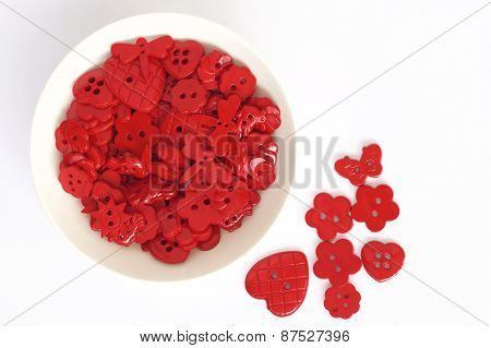 Red Buttons on a Plate