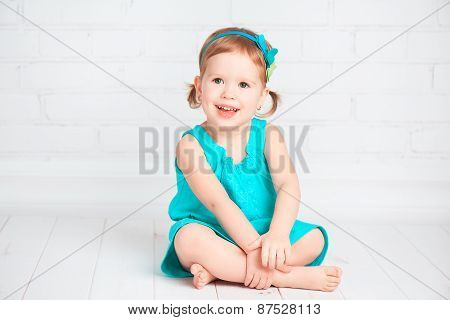 Beautiful Little Baby Girl In A Turquoise Dress