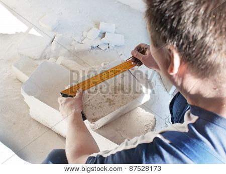 Worker Measures The Ruler Silicate Brick