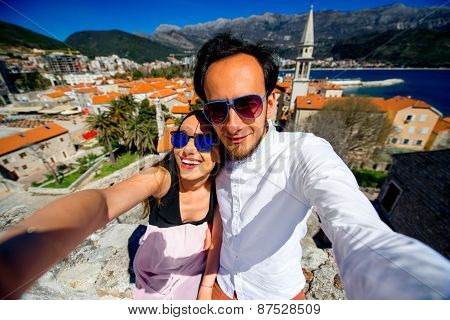Couple taking self portrait in Budva