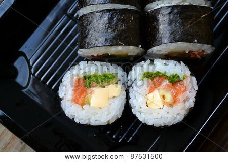 Delicious rolls and sushi with salmon and cream cheese