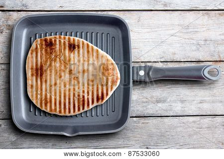 Tasty Grilled Naan Flatbread On A Square Pan