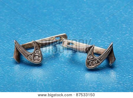 Silver Earring With A Crescent On A Blue