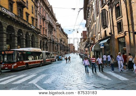 People And Vehicles On Via Francesco Rizzoli In Bologna. Italy