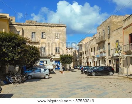 People And Cars Near The Church  Of The Piazza Matrice In Favignana, Sicily