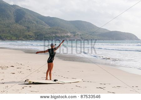 Surfing Woman With Surfing Board On The Beach