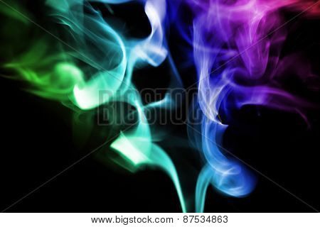 colored smoke on a black background