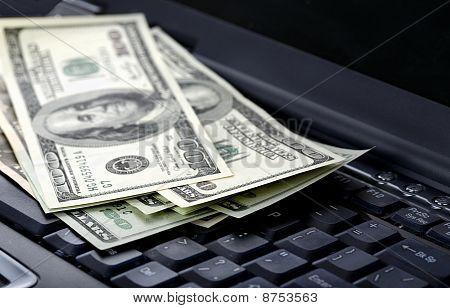 American Dollars Laying On Laptop