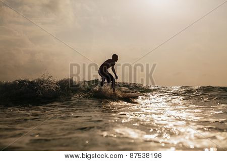 Surfing Man Silhouette In Waves