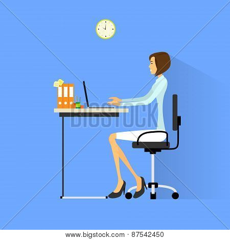 business woman sitting at desk in office working laptop computer
