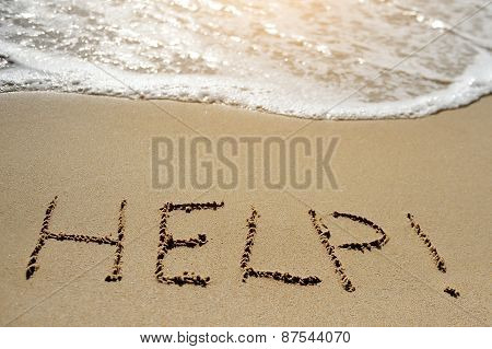 Help Written On Sand Beach