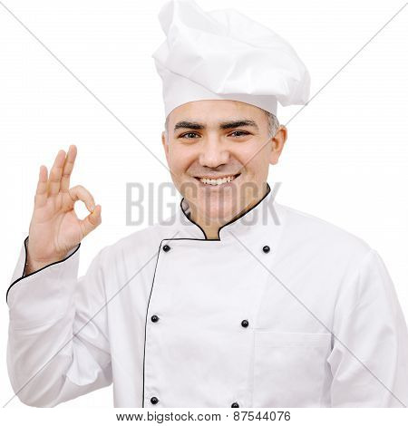 Chef Dressed In White Uniform Showing Ok Sign Isolated On White Background