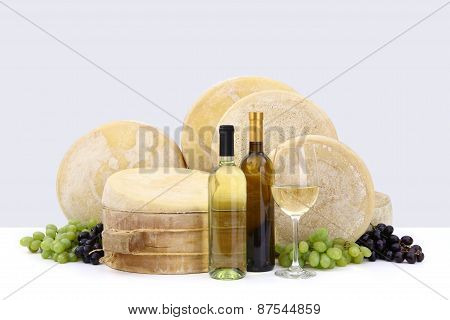 various types form of cheese with wine, grapes