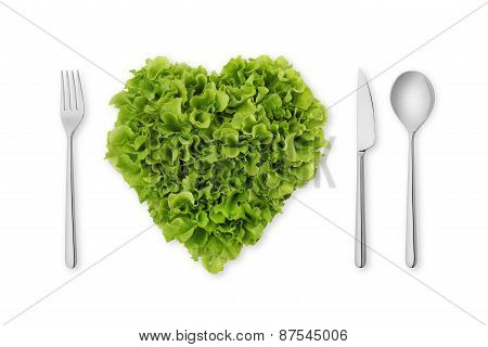 heart shaped salad lettuce with fork spoon knife
