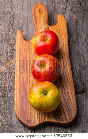 Fresh Apples On Wooden Cutting Board